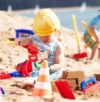 Vorschau: Backsteinform Sandspielzeug grüner Griff